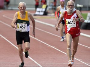 Peru's Antonio Delgado Flores (R), Australia's James Sinclair (C) and Brazil's Mamoru Ussami (L) compete in the men's 100m final for athletes over 90 years old, during the World Masters Athletics Championships on August 7, 2015 in Lyon, southeastern France. AFP PHOTO/PHILIPPE DESMAZES